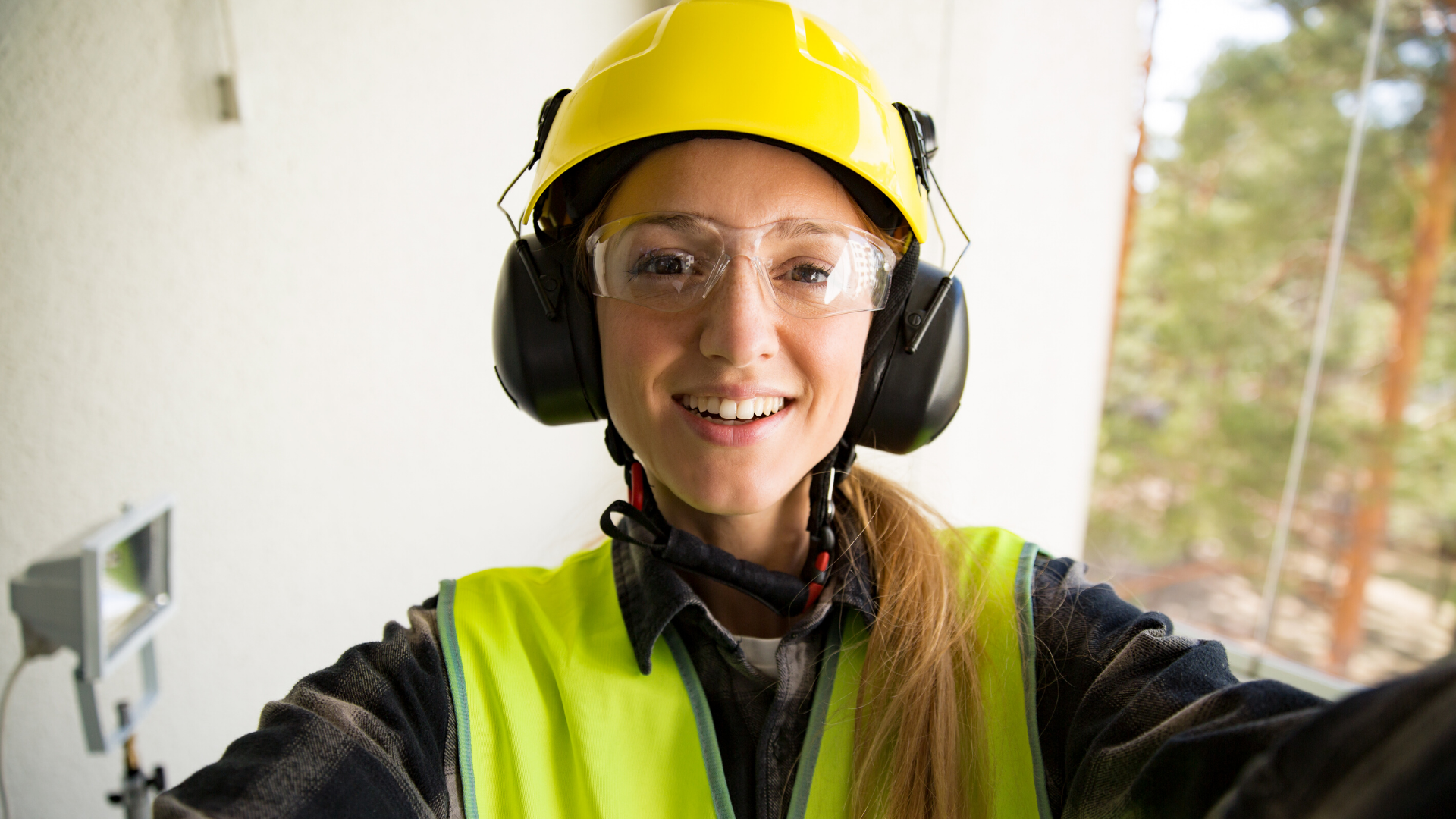 Smiling woman in high vis jacket and hard hat
